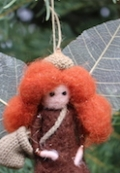 Garden fairy with gossamer wings and red hair.