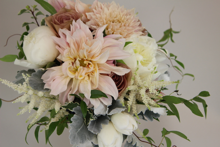 White peonies, tulips and astilbe in wedding bouquet