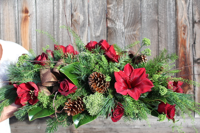 Christmas Arrangement with red amaryllis, roses and mixed evergreens
