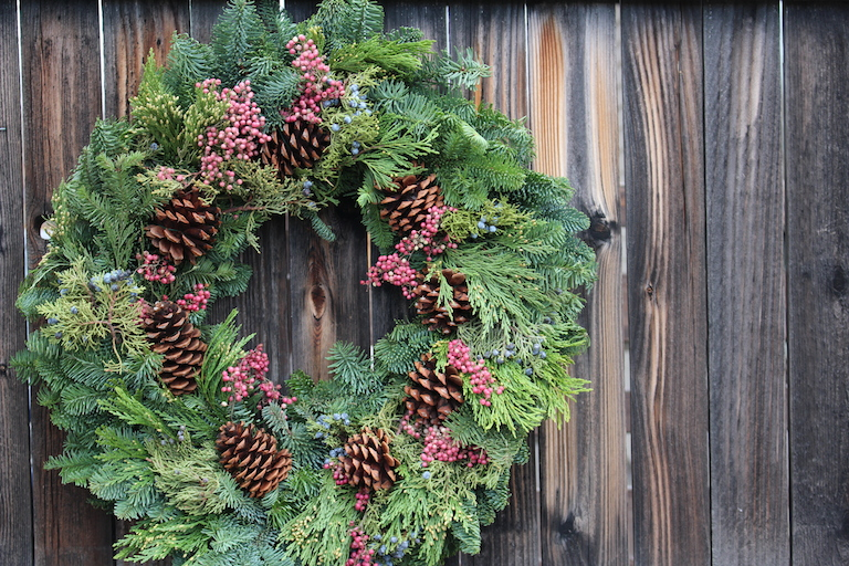Wreath with pink pepper berries and blue juniper