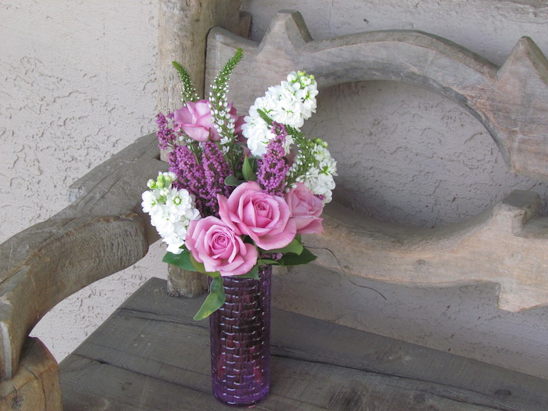 Heather with white stock and lavender roses $58.00