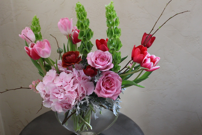 Tulips with bells of Ireland and roses $115.00