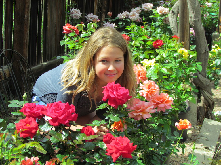 Tatum in the rose garden at Sturtz and Copeland