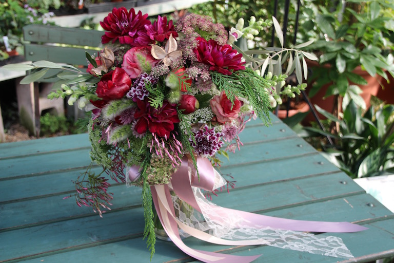 Bridal bouquet with burgundy dahlias and satin ribbon