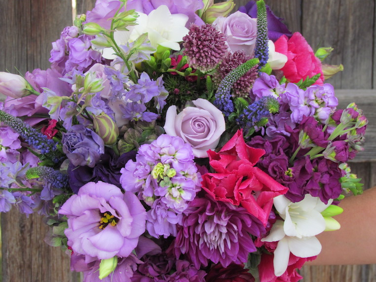 Pink godetia, purple stock, lavender lisianthus and roses