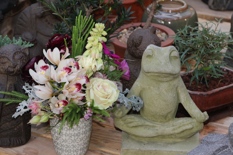 Yoga frog with cymbidium spray
