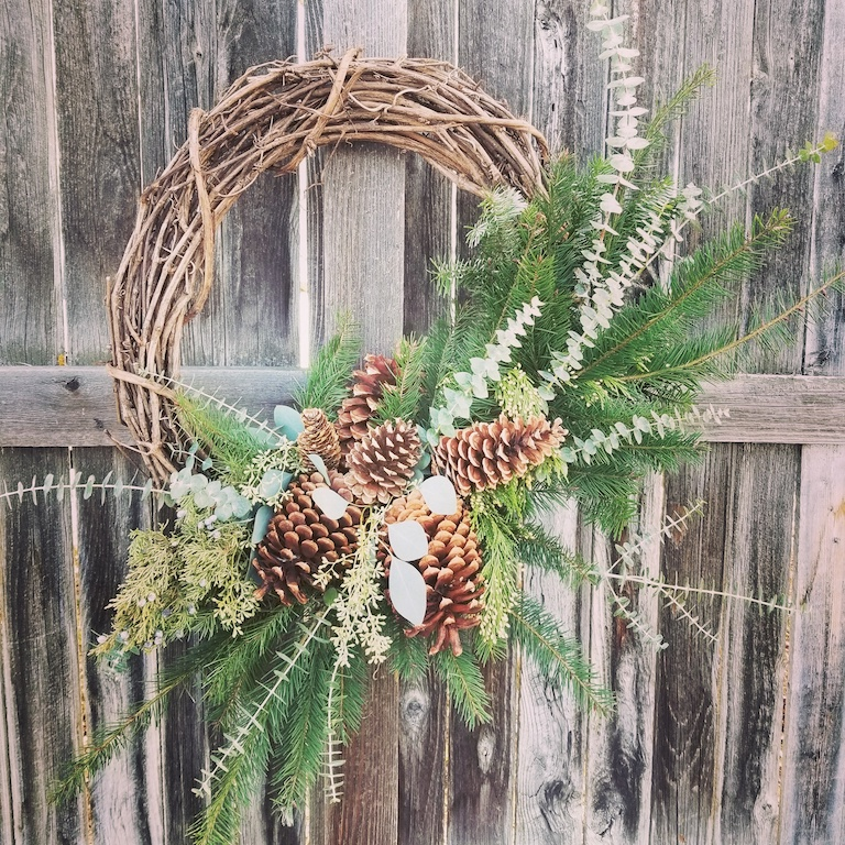 Willow wreath with pinecones and evergreen