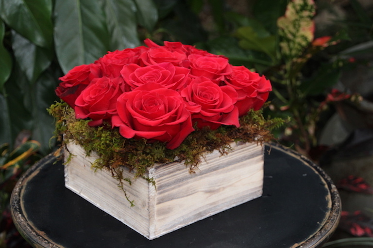 Red Roses arranged in a rectangular wooden box