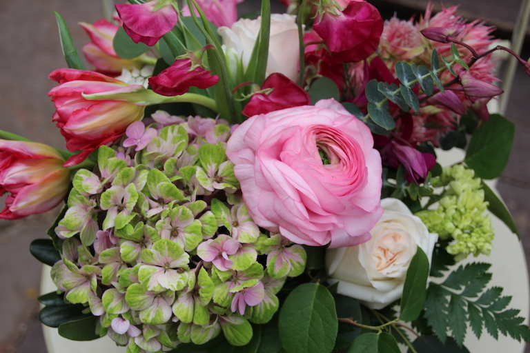 Green and pink hydrangeas with pink ranunculus