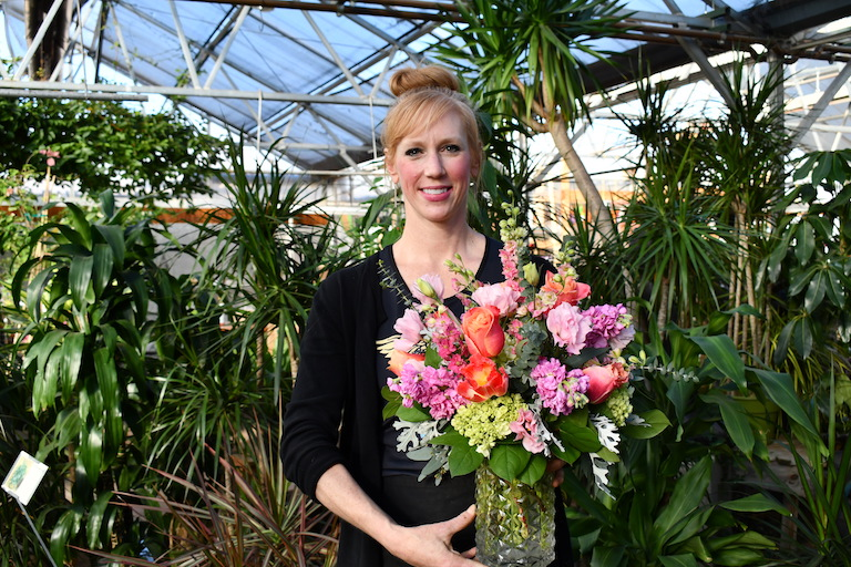Mandy with a beautiful spring Easter flower arrangement